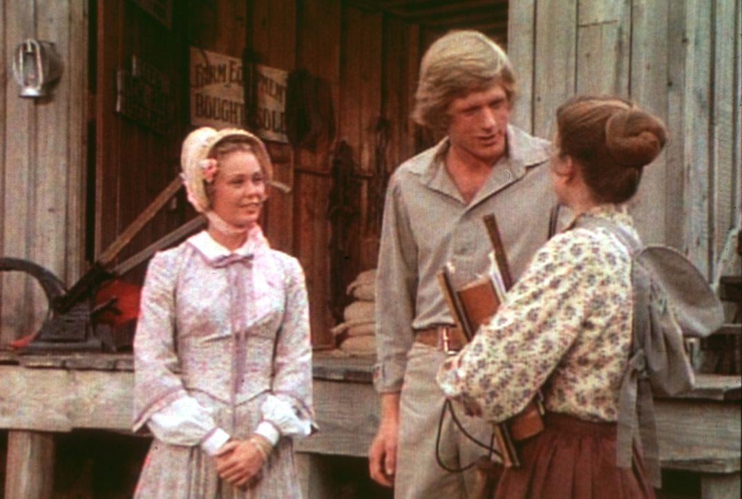 Laura (Melissa Gilbert, r.) tobt vor Eifersucht. Vergeblich versucht ihr Almanzo (Dean Butler, M.) zu erklären, dass Brenda Sue (Tisch Raye, l.) nur... - Bildquelle: Worldvision