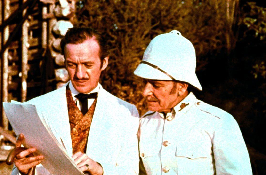 Phileas Fogg (David Niven, l.); Zugbegleiter (Ronald Colman, r.) - Bildquelle: 1984 Warner Bros. Entertainment Inc. All rights reserved.