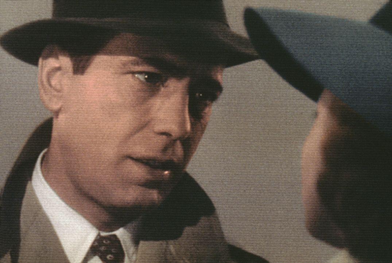 Verzichtet auf das große Glück: Nachtclubbesitzer Rick Blaine (Humphrey Bogart) ... - Bildquelle: Warner Bros. Television