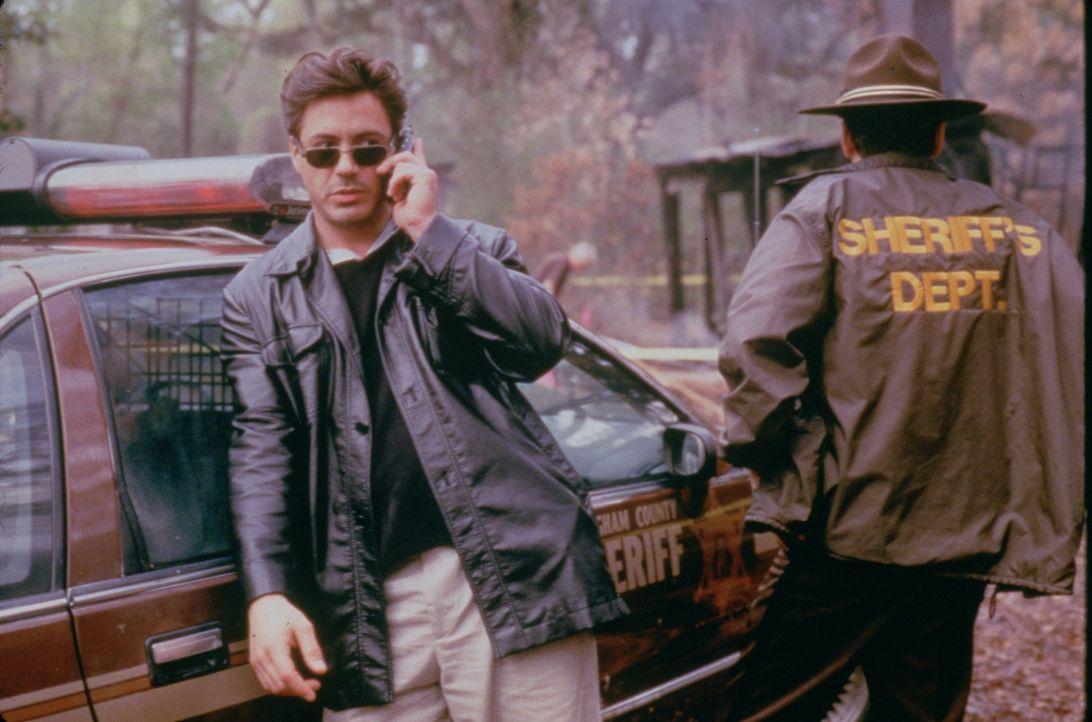 Clyde Pell (Robert Downey Jr., l.) - Bildquelle: 1997 Polygram Films. All Rights Reserved.
