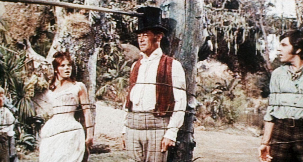 Auf ihrer Abenteuerreise werden Emma (Samantha Eggar, l.), Dolittle (Rex Harrison, M.) und Matthew (Anthony Newley, r.) von Eingeborenen gefangengen... - Bildquelle: 20th Century Fox Film Corporation