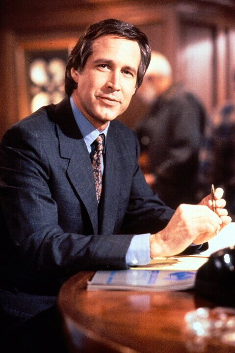 Lockeres Leben: Finanzspezialist Nick Halloway (Chevy Chase) geht erfolgreich den Weg des geringsten Widerstands. - Bildquelle: 1992 Warner Bros., Inc., Regency Enterprises VOF and Studio Canal+.  All rights reserved.