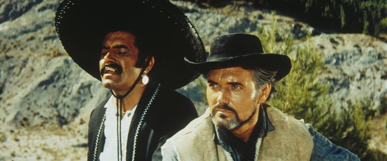 Der skrupellose Gauner Quilerva (Miha Baloh, l.) und sein Boss Silers (Harald Leipniz, r.) überlegen, wie sie den Tod von Silers' Bruder rächen könn... - Bildquelle: Tobis Film