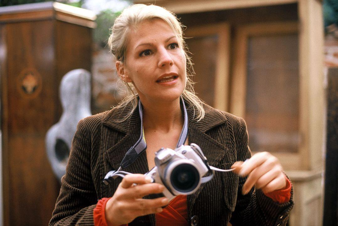 Unverhofft trifft Clara (Sophie Schütt) bei einer Fotoreportage ihren Traumprinzen wieder. - Bildquelle: manju.de Sat.1