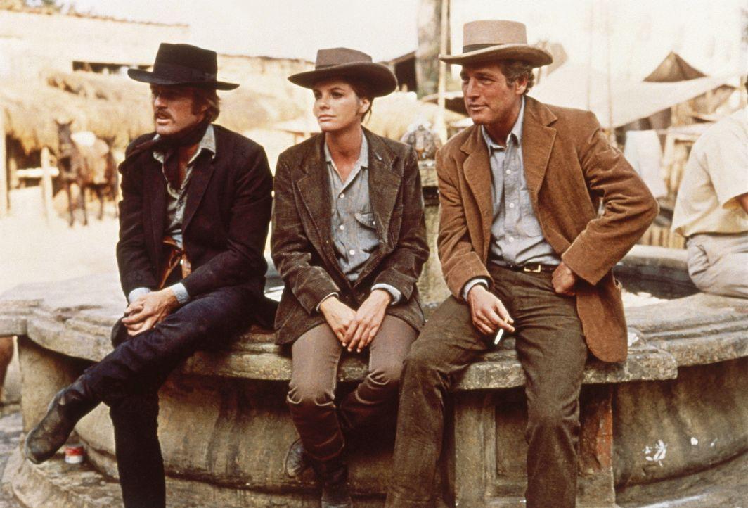 Fliehen gemeinsam nach Bolivien: Butch Cassidy (Paul Newman, r.), Sundance Kid (Robert Redford, l.) und Etta (Katharine Ross, M.) ... - Bildquelle: Twentieth Century-Fox