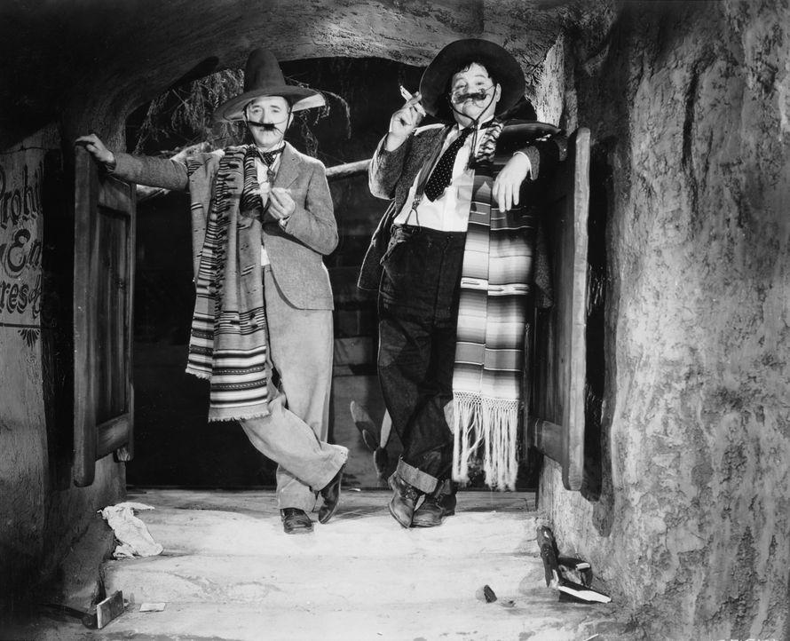 Oliver Hardy (l.); Stan Laurel (r.) - Bildquelle: Warner Bros.