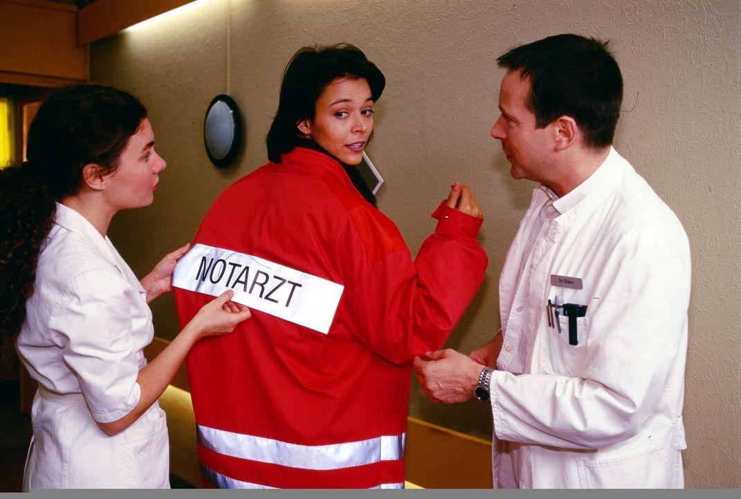 Corry Lenz (Yvonne de Bark, M.) gerät durch eine Geiselnahme in das Luisenkrankenhaus. Die ehemalige Krankenschwester konnte leider nicht verhinder... - Bildquelle: Noreen Flynn Sat.1